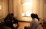 Students writing poetry in front of Tobi Kahn's work