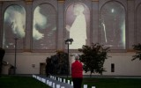 An onlooker stands before Ben Wood's 9/11 memorial projection just before sundown.